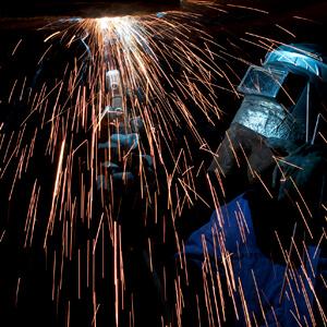 Welder Welding with Sparks